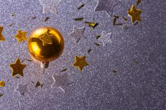 Silver and golden christmas bubbles. Golden christmas bubble with stars and particles on silver background royalty free stock photos