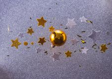 Silver and golden christmas bubbles. Golden christmas bubble with stars on silver background stock photos