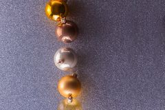 Silver and golden christmas bubbles. Set of silver and golden christmas bubbles with copy space on gray background stock photography