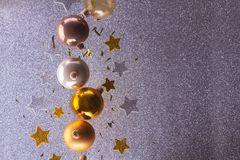 Silver and golden christmas bubbles. With copy space on gray background royalty free stock photography