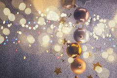 Silver and golden christmas bubbles. With copy space on gray background, retro toned stock photography