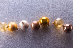 Silver and golden christmas bubbles. Row royalty free stock photography
