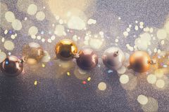 Silver and golden christmas bubbles. Row, retro toned royalty free stock photo
