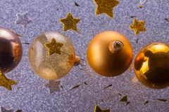 Silver and golden christmas bubbles. With stars close up royalty free stock photos
