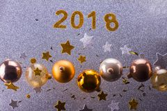 Silver and golden christmas bubbles. And stars with 2018 new year sign stock photography