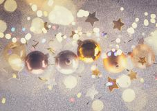 Silver and golden christmas bubbles. And stars, retro toned stock photography