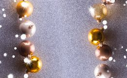 Silver and golden christmas bubbles. Stylrd scene with copy space stock images
