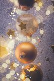 Silver and golden christmas bubbles. With stars close up, retro toned royalty free stock photo