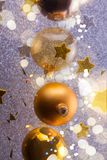 Silver and golden christmas bubbles. With stars close up with shining bokeh lights stock photos