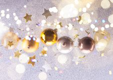 Silver and golden christmas bubbles. And stars with shining bokeh lights royalty free stock photos