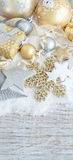 Silver and golden Christmas decorations. Ans gift boxes close up Stock Images
