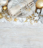Silver and golden Christmas Table Setting. With christmas decorations Stock Photo