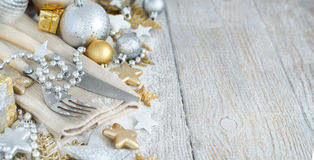 Silver and golden Christmas Table Setting. With christmas decorations Stock Photos