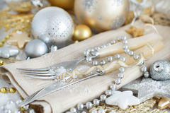 Silver and golden Christmas Table Setting. With christmas decorations Royalty Free Stock Photography