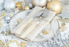 Silver and golden Christmas Table Setting. With christmas decorations Royalty Free Stock Images