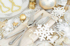 Silver and golden Christmas Table Setting. With christmas decorations Stock Photography
