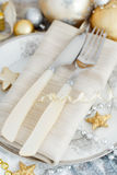 Silver and golden Christmas Table Setting. With christmas decorations Royalty Free Stock Photos