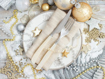 Silver and golden Christmas Table Setting. With christmas decorations top view Royalty Free Stock Images