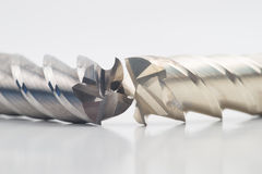 Silver and golden end mill cutter Royalty Free Stock Image