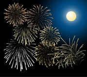 Silver and golden fireworks. With moon on the background Stock Photo