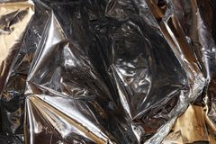 Golden, silver foil. Silver-golden foil as background for design and wallpaper royalty free stock image