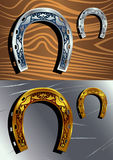 Silver and golden horseshoe Stock Images
