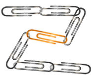 Silver and golden paper clips isolated over white Royalty Free Stock Photo