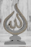 Silver and Golden Religious Statuette with the Name of Allah Royalty Free Stock Photos