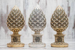 Silver and Golden Religious Statuettes with the Names of Allah. The God written on them stock image