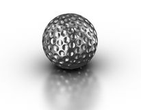Silver golf ball on reflective white background Royalty Free Stock Photography