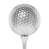 Silver golf ball on tee closeup isolated on white Royalty Free Stock Photography