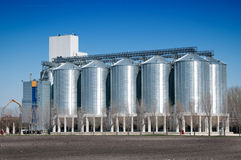 Silver Grain Silos with blue sky in background Stock Images
