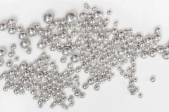 Silver Granules. Pure silver granules on a white background Royalty Free Stock Photography
