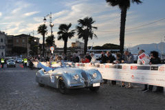 A silver gray Jaguar XK 120 OTS. DESENZANO (BS), ITALY - MAY 15: A silver gray Jaguar XK 120 OTS takes part in the 1000 Miglia classic car race on May 15, 2014 Stock Photos