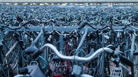 Silver and Gray Metal Bikes Parked in Rows Outside Stock Photography