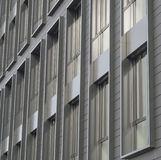 Silver gray windows of modern building architectonic detail. Background stock photo