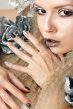 Silver grey beige makeup and manicures Stock Images