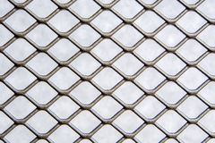 Free Silver Grey Color Metal Wire Mesh Fence With Grey Background Royalty Free Stock Photography - 135650987