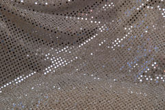Silver grey polka dot sequined fabric background Royalty Free Stock Photo