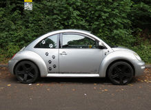 Silver grey Volkswagen New Beetle car in Oxford Stock Image