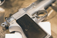 Silver Gun on Wooden Table Close Up Stock Images