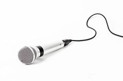 Silver handheld ball head microphone. Silver handheld ball head microphone isolated on white background royalty free stock photo