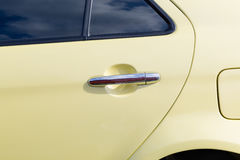 Silver handle on the door of retro car Stock Image