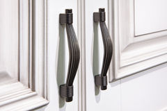 Silver handles on cabinet doors Royalty Free Stock Images