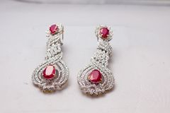 Silver handmade earings with big red rubies. Handmade silver earings jewellery with bi red rubies Stock Photo