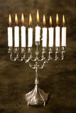 Silver hanukkah. Nine candles in a silver jewish hanukkah candle holder Stock Photos
