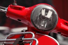 Silver Headlight on Red Motorcycle Stock Images