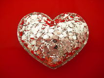 Silver heart. Shape on red Royalty Free Stock Photos