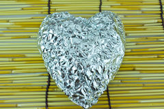 Silver heart on bamboo blind Royalty Free Stock Images