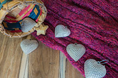 Silver heart, basket ,scarves, on wooden decorated for Valentine Stock Photography